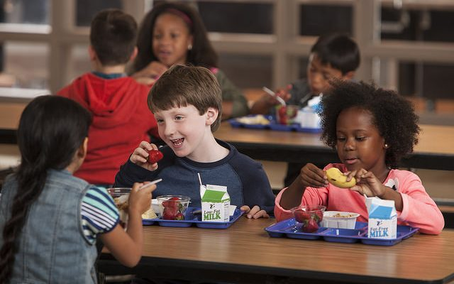 children eating breakfast at school