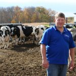Wisconsin Farmers Union President Darin Von Ruden is pictured on his Vernon County dairy farm. WFU is asking legislators to ensure that the Trans-Pacific Partnership include binding provisions on currency manipulation to protect U.S. farmers. Nearly 80 percent of respondents in a survey of Wisconsin dairy farmers conducted by WFU this fall favored Congress rejecting or placing a moratorium on the TPP in its current form until concerns over imported Milk Protein Concentrates (MPCs) and other low-cost imports are resolved. (Courtesy of Wisconsin Farmers Union)