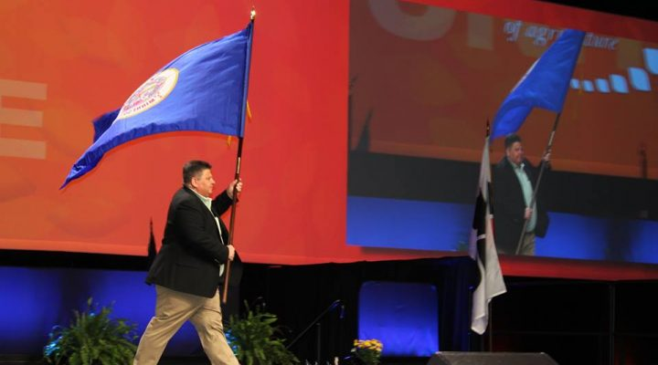 MFBF President Kevin Paap during the opening session of the AFBF Annual Convention presenting Minnesota's flag. (Minnesota Farm Bureau Federation via Facebook)