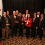 """Brad and Karen Hines (center) received the 2016 """"Outstanding Young Farm Family"""" award during Kentucky Farm Bureau's annual meeting in Louisville. Presenting the award are Mark Haney, KFB President (left) and David S. Beck, KFB Executive Vice President (right). (Kentucky Farm Bureau)"""