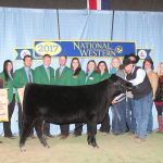 Charles W. and Judy Herbster, Herbster Angus Farms, Falls City, Neb., purchased the Angus Foundation Heifer Package for $170,000 at the 2017 National Western Angus Bull Sale, Jan. 11 in Denver, Colo. Doug and Sharon Stevenson, Basin Angus Ranch, Joliet, Mont., donated the heifer. Pictured from left are: Milford Jenkins, Angus Foundation president; Gabrielle Lemenager, National Junior Angus Board (NJAB) communications director; Miss American Angus Keegan Cassady; Macy Perry, NJAB chairman; Braden Henricks, NJAB Foundation director; Tim Marsdesen, NJAB leadership director; Reese Tuckwiller, NJAB vice chairman; Catie Hope, NJAB director; Maddi Butler, NJAB director; Katelyn Corsentino, NJAB membership director; Nicole Stevenson; Doug and Sharon Stevenson; Courtney B. Coughlin, Herbster Angus Farms; Charles W. Herbster; Chris Stephens, Angus Foundation assistant director of development; Allen Moczygemba, American Angus Association CEO; and at the halter lead is Brian Barragree. The package includes 30 days of free insurance from American Live Stock Insurance Co., Geneva, Ill.; free transportation to the buyer's ranch provided by Lathrop Livestock Transportation, Dundee, Ill.; and an advanced reproductive technology package from Trans Ova Genetics and its cloning division, ViaGen, Sioux Center, Iowa. Photo by Chris Jeffcoat, American Angus Association.