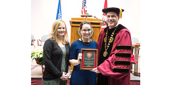 (L-R): Amy Rietkerk, CHS Stewardship Coordinator, and Tera Fair, Communications Specialist, accepting the Outstanding Service Award from UW-River Falls Chancellor Dean Van Galen. (Courtesy of UW-River Falls)