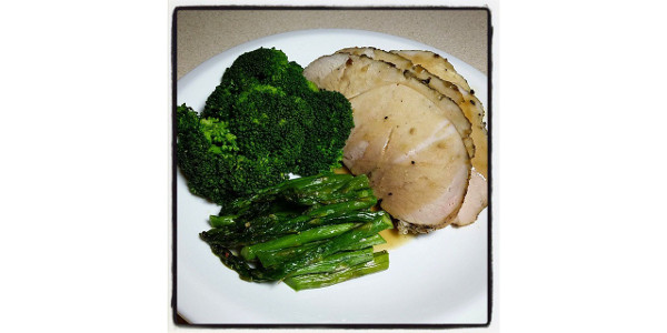 Garlic herb pork sirloin tip roast served with roasted asparagus and steamed broccoli. (Bruce Matsunaga via Flickr)