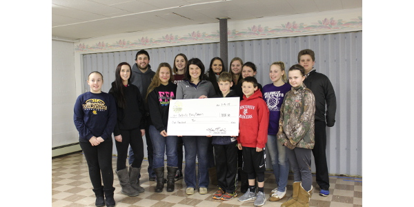 The Wisconsin Farm to Table organization donated proceeds from their 2016 event to the Busy Beavers 4-H Club of Belleville, Wis. On January 9th, Wisconsin Farm to Table presented a check to the Busy Beavers club to celebrate their volunteer work at the Wisconsin Farm to Table event, which took place on July 30th at Sunburst Dairy, owned by Yogi and Bryan Brown. (Courtesy of Wisconsin Farm to Table)