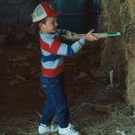 A child pitching hay. (Ron Jones via Flickr)