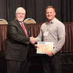 Kristofer Ehler (right) of Ehler Brothers Seed, Thomasboro, Ill., receives the CCA Soybean Master Adviser award from John Longley, Illinois Soybean Association Production and Outreach Committee chair. (Courtesy of Illinois Soybean Association)
