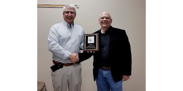 """Ron Meyer presented past Colorado Sunflower Administrative Committee board member Leon Zimbelman with an """"Outstanding Service"""" recognition plaque. (Courtesy of Colorado Sunflower)"""