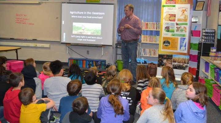 Brad Greenway, a Mitchell pig farmer, presenting to fourth grade students in Mitchell during Ag Week 2016. (Courtesy of Ag United for South Dakota)