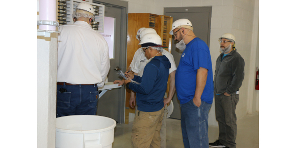 Course participants apply their classroom knowledge to visual, hands-on learning in the KSU Hal Ross Flour Mill.
