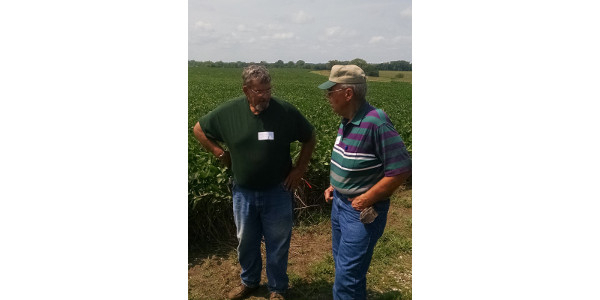 Russ Brandes (left) speaks with Paul Ackley during a 2016 Practical Farmers field day. (Courtesy of Practical Farmers of Iowa)