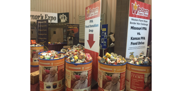 """FFA students from Missouri and Kansas who recently attended the Western Farm Show in Kansas City made a major contribution to the fight against hunger by collecting 5,958 canned goods and other non-perishable items in the show's annual """"Border War"""" Food Drive. (Courtesy of Western Farm Show)"""