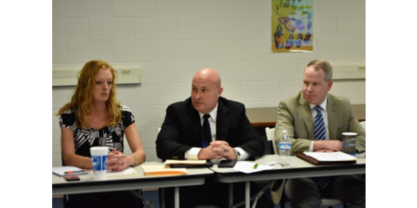 John Cook is flanked by grain inspector Carrie Pendleton and legal counsel Joe Bibly. (Courtesy of Farmstead Media)