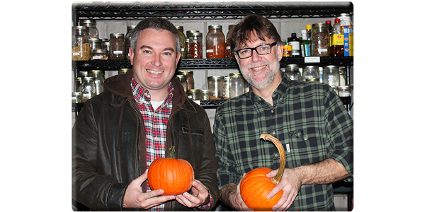 Mark Jensen, right, owner/executive chef of middle fork kitchen bar, and Agriculture Commissioner Ryan Quarles hold Kentucky Proud pumpkins from Stonehedge Farm in the fall of 2016 that Jensen used to make fire-roasted candy pumpkins. (Kentucky Department of Agriculture photo)