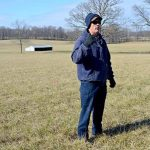Anderson County producer Mike Wilson talks about his hayfield seeded in novel endophyte tall fescue, which is in the background. (PHOTO: Katie Pratt, UK Agricultural Communications)