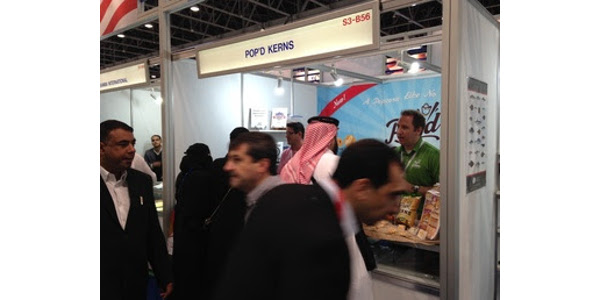 Caleb Krienke of Pop'd Kerns fields questions and navigates a great deal of traffic at his booth in the USA Pavilion at Gulfoods 2017 in Dubai. (Photo by Emily Jerve, 2017)