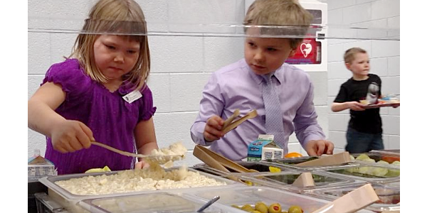 Home-made potato salad self-served from the low profile salad bar was a hit with kindergartners in Park River. (Courtesy of Northern Plains Potato Growers Association)