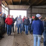 Brett Friedrichsen (to the left) visits with Animal Science 426 students about how a monoslope barn is designed and managed. (Courtesy of ISU Extension and Outreach)