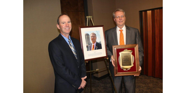 Kevin Satterwhite, Chairman of the South Carolina Dairy Hall of Fame and the South Carolina Farm Bureau Federation Dairy Advisory Committee presented Parr with his award at a ceremony at the Headquarters of the South Carolina Farm Bureau Federation. (Courtesy of SC Farm Bureau Federation)
