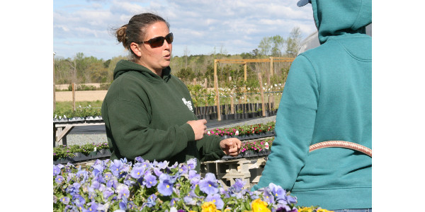 J.J. Faulk speaks with a staff member at JJ's Place Greenhouse and Nursery, a business she owns and operates with husband Ryan in Lee County. (Courtesy of N.C. Cooperative Extension)