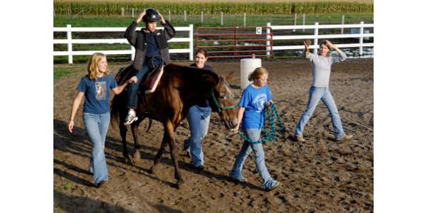 A rider works on warmup exercises during a therapeutic riding lesson. (NDSU photo)