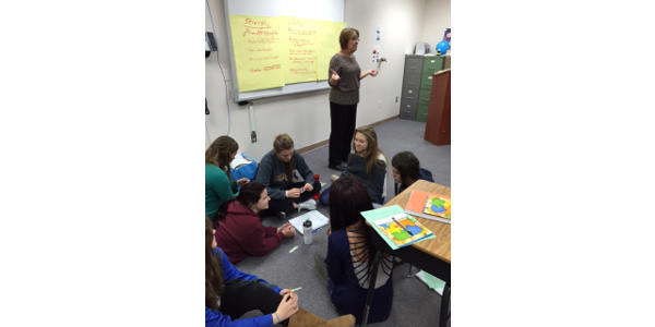 Tenth-graders participating in the Stronger Communities Together program tackle community challenges with assistance from Carmen Rath-Wald, an Extension agent in Logan County. (NDSU photo)