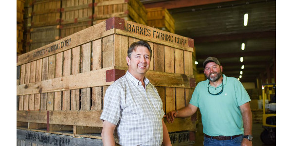 Johnny Barnes, who helped create the Executive Farm Management Program, with his tobacco farm manager Bryan Salmons. Salmons is taking part in the program's inaugural class. (Courtesy of NC State University)