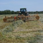 Raking hay in preparation for baling. (MUExtension417 via Flickr)