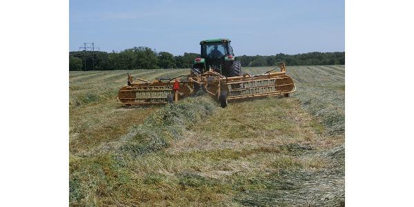 Raking hay in preparation for baling. (MUExtension417 via Flickr)