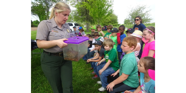 Sarah Haslett, Natural Resource Specialist with Lake Shelbyville Army Corp of Engineers teaches students about native turtles at the Christian County Conservation Day. (Courtesy of University of Illinois Extension Unit 18)
