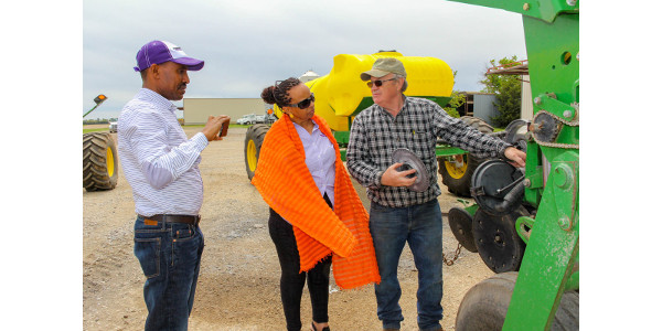 USDA Cochran Program for Ethiopia participants Aman Mohammed and Abeba Meteku learn about growing wheat from Joe Kejr at his farm near Brookville, Kansas. (Courtesy of IGP Institute)