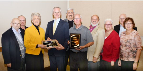 Councilman Tom Black, Treasurer Ralph Luebbert, Mayor Marlene Johnson, Lt. Governor Mike Foley, City Administrator Tom Goulette, Councilman Bruce Schlecht, Councilman Jerry Hugo, Councilwoman Debra Ell, Councilman Roger Paus, Clerk Mary Kempf. (Courtesy of Nebraska Department of Economic Development)