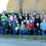 Margaret Sumption (center) with her children and their families on the family's South Dakota farm near Frederick. (Photo by Kaylee Speck Photography)