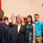 Judge Mary Rhodes Russell administered the oath at the Missouri Supreme Court Building in front of Director Chinn's daughter, son and mother-in-law. (Courtesy of Missouri Department of Agriculture)