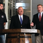 Agriculture Commissioner Ryan Quarles, right, announces the collaboration of Kentucky Proud, the Kentucky Guild of Brewers, and Kentucky State University with, from left, Derek Selznick, executive director of the Guild, and state Rep. Phillip Pratt on Wednesday at Country Boy Brewing in Georgetown. (Kentucky Department of Agriculture photo)