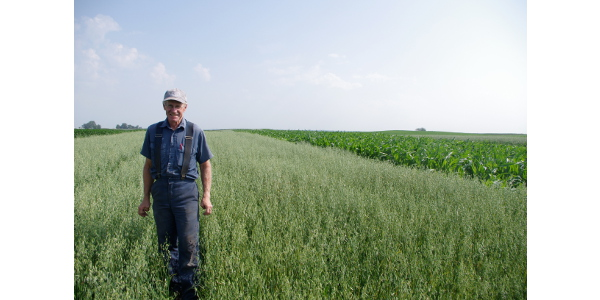 Craig Fleishman in oats. (Courtesy of Practical Farmers of Iowa)