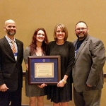 The Kansas Department of Agriculture food safety and lodging program was honored with the Elliot O. Grosvenor Food Safety Award at the recent Association of Food and Drug Officials annual event in Texas. KDA staff accepting the award were: (from left) Adam Inman, assistant program manager; Lisa Lilienthal, food/drug/lodging surveyor; Autumn Schuck, inspection manager; and Steve Moris, program manager. (Courtesy of Kansas Department of Agriculture)
