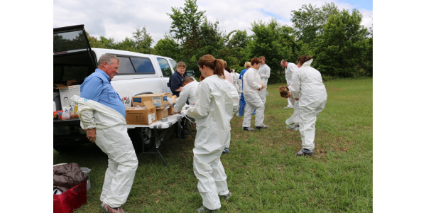 Participants learned the importance of donning and doffing protective gear and clothing during a biosecurity training exercise by Clemson University. (Image Credit: Denise Attaway / Clemson University)