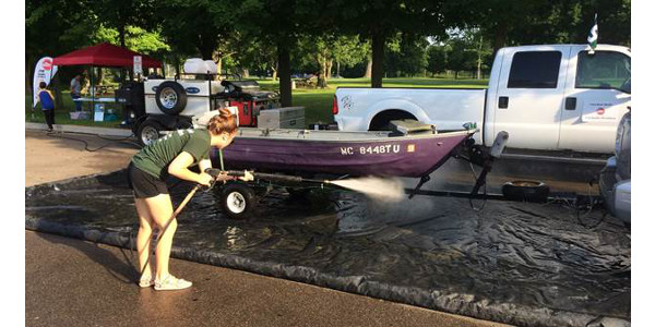 A boat wash event will be hosted at Paw Paw Lake on Friday, July 7th to help boaters remove even microscope reproductive parts of invasive species, such as zebra mussels and Eurasian water milfoil. (Courtesy of USDA NACD)