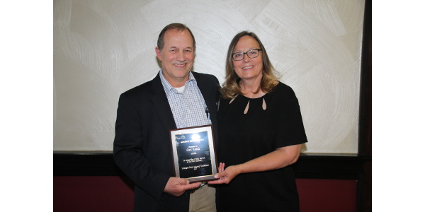 Carl Rasch with his wife, Roxanne, accepted the 2017 Michigan Dairy Industry Service award on June 1 during the annual Michigan Dairy industry Conference in Lansing, Michigan. (Courtesy of Michigan Milk Producers Association)