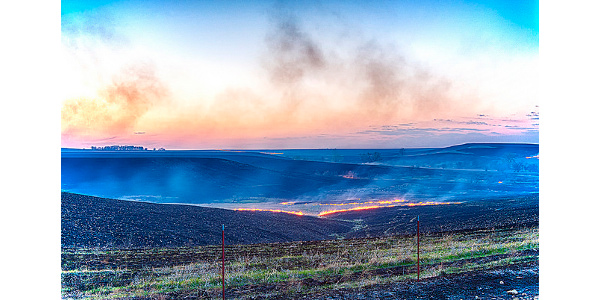 A controlled burning of the dry grass on the Kansas Flint hills. (Patrick Emerson via Flickr)