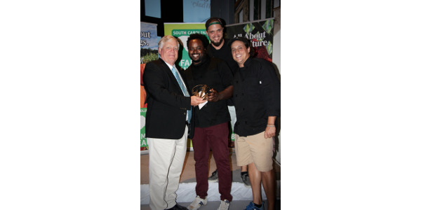 SCFB Harry Ott (L) presents the Top Chef Award to Columbia's 2 Fat to Fly's head chef Ramone Dickerson (center) and crew at the tenth annual Palmetto Palate hosted by the South Carolina Farm Bureau Federation. (Courtesy of South Carolina Farm Bureau)