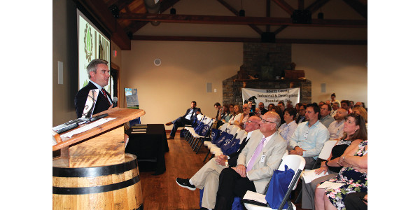 Agriculture Commissioner Ryan Quarles addresses a capacity crowd for the second of three LAND meetings at Jeptha Creed Distillery in Shelby County on Wednesday. (Kentucky Department of Agriculture photo)