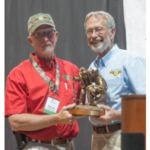 Conrad Arnold, National 4-H Shooting Sports program coordinator presents Extension educator Steve Pritchard with the Bill Stevens 4-H Leadership Award. (Courtesy of UNL)