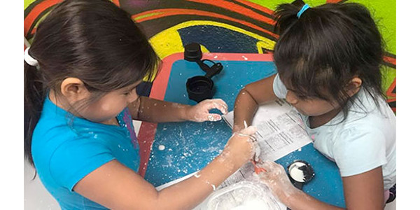 Two young girls participate in an activity during a STEM lesson at the Kickapoo Tribal Nation recently. (Courtesy of K-State Research and Extension)