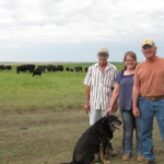 South Dakota Farmers Union has served South Dakota farm and ranch families for more than a century. Throughout the year, we share their stories in order to highlight the families who make up our state's No. 1 industry and help feed the world. This month we celebrate the Springer farm family who farms and raises cattle together near Dixon. Pictured here with farm dog, Cruizer, are brothers, Terry (left) and Wayne (right) and Wayne's wife, DenaMarie. (Courtesy of Lura Roti)