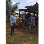 Deputy Commissioner Matt Wohlman (left) visiting a farm in Cuba as part of a trade delegation in June. (Courtesy of Minnesota Department of Agriculture)