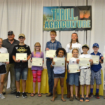 "Iowa Secretary of Agriculture Bill Northey recognized thirteen students from Iowa at the State Fair for providing the artwork that appears in the ""From the Farm to You"" calendar. (Courtesy of Iowa Department of Agriculture)"