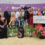 Pictured with the WHA Futurity Champion Ryan-Vu Chelios Mocha, seated in the front row from left to right, is WI State Fairest of the Fairs Rebecca Starkenburg and Alice in Dairyland- Crystal Siemers-Peterman. In the back row from left to right, WI Holstein Association Princess Attendant Kelsey Cramer, WI Secretary of Ag Ben Brancel, Cameron Ryan, Mark Ryan, Mary Ryan, Dylan Ryan, Amy Ryan, Chad Ryan, WI Holstein Princess Courtney Moser, WHA Futurity judge Jerome Meyer, and Compeer Financial Representative Dawn Haag. (Courtesy of Wisconsin Holstein Association)