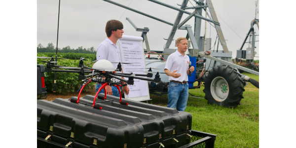 Phillip Williams (right) and Jonathan Fox, discuss precision agriculture technologies at the Edisto Research and Education Center. (Image Credit: Scott Miller / Clemson University)