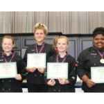 Agriculture Commissioner Ryan Quarles, right, presents the Junior Chef state championship trophy to members of the Montgomery County High School 4-H Culinary Team: from left, Jamila Green, Hayden Holley, Jennie Walters, Landon Holley, and Mackenzie Green. (Kentucky Department of Agriculture photo)